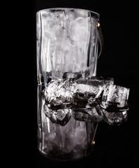 Ice and ice bucket over black background