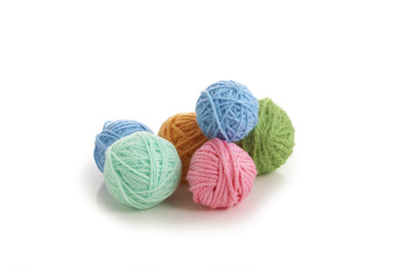 color yarn ball on white background