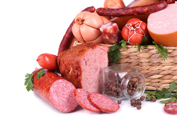 Lot of different sausages in basket isolated on white