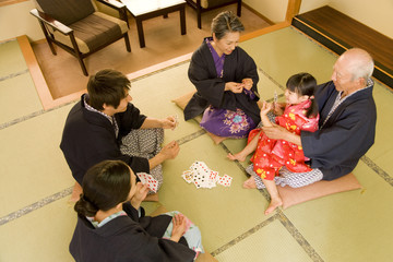 three-generation family playing cards