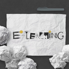 design word E-LEARNING on dark crumpled paper and texture backgr