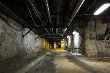 inside an old industrial building, basement Wall mural
