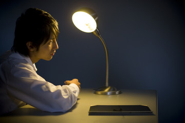 man sitting on desk in interrogation room