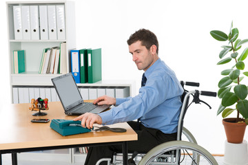 man in wheelchair on workplace