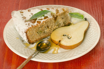 Wall Mural - Slice of pear pie with honey on red wooden table