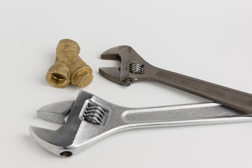 adjustable wrench and a pipe