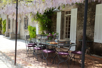 Table on the porch under blooming Wisteria