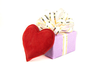 Gift box and heart on white background