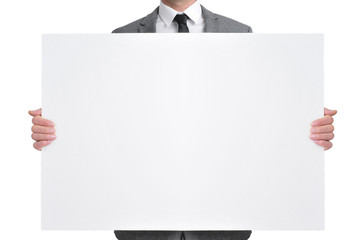 Wall Mural - man in suit holding a blank signboard