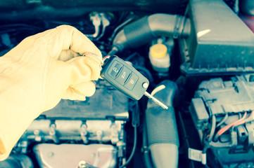 hand holding a car key