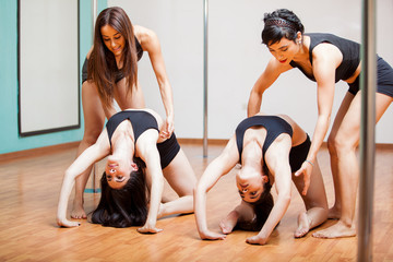 Pole fitness students during class