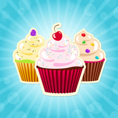 Assorted cupcakes on blue background