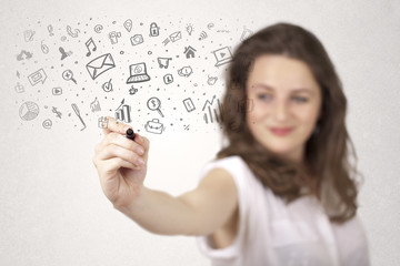 Young woman drawing and sketching icons and symbols