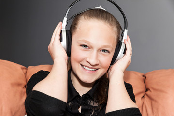 Happy girl singing with headphones