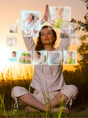 Sporty woman outdoors working out using modern virtual interface