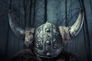 Helmet, Viking warrior, male dressed in Barbarian style with swo