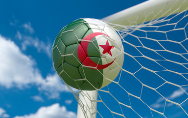 Algeria flag and soccer ball in goal net