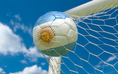 Argentina flag and soccer ball in goal net