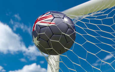 Australia flag and soccer ball in goal net