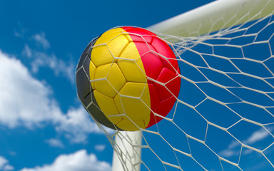 Belgium flag and soccer ball in goal net