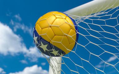 Bosnia flag and soccer ball in goal net