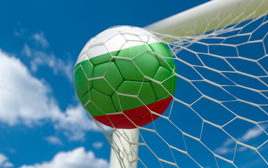 Bulgaria flag and soccer ball in goal net