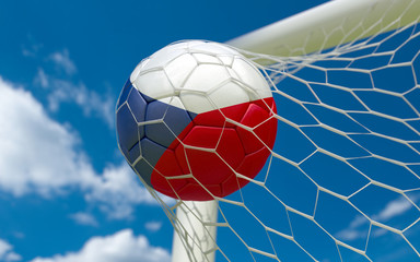 Czech Republic flag and soccer ball in goal net