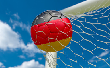 Germany flag and soccer ball in goal net