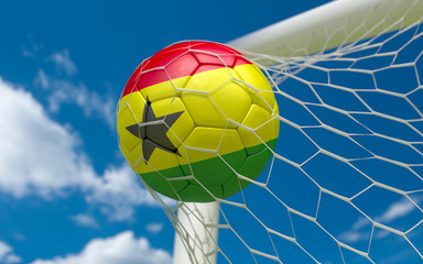 Ghana flag and soccer ball in goal net