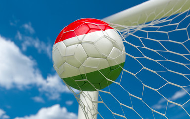 Hungary flag and soccer ball in goal net