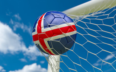 Iceland flag and soccer ball in goal net