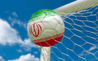 Iran flag and soccer ball in goal net
