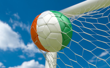 Ivory Coast flag and soccer ball in goal net