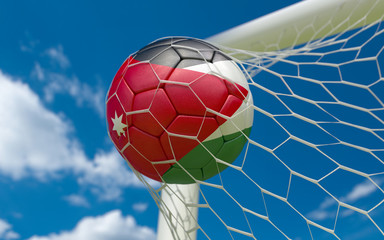Jordan flag and soccer ball in goal net