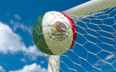 Mexican flag and soccer ball in goal net