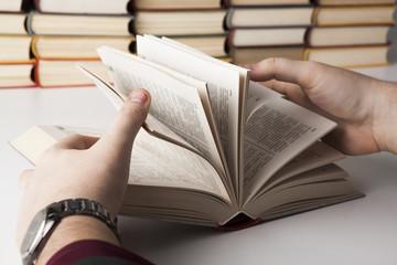 man holding an open book 2