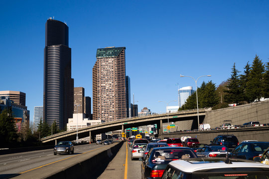 Interstate 5 Highway Cuts Downtown Seattle Skyline During Rush H