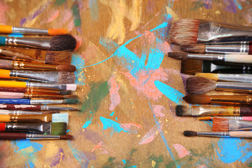 Brushes on multicolor  wooden background