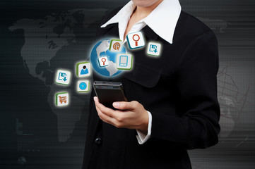 Wall Mural - Application icons and mobile in human hand. Concept of E-busines