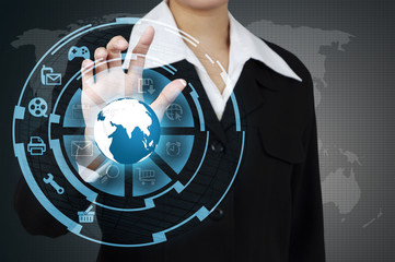 Wall Mural - Business woman touching the globe and icon application on virtua