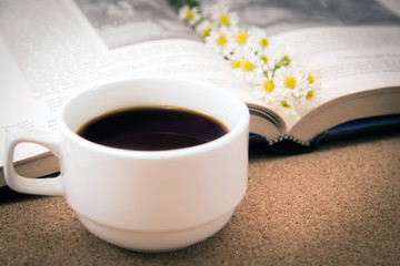 A Cup of coffee and a book.