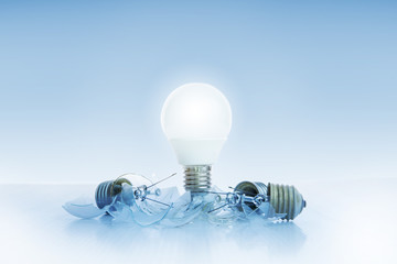 abstract of led light bulb glowing on light blue background with