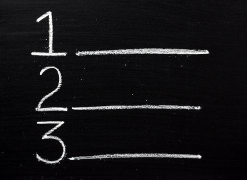 One,Two or Three list written on a blackboard