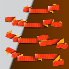 Four red ribbons with yellow stripes