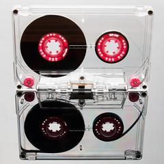 Audio cassette tape, pink. Mirrored.
