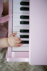 Baby hand playing piano