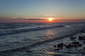 The sun is setting over the baltic sea