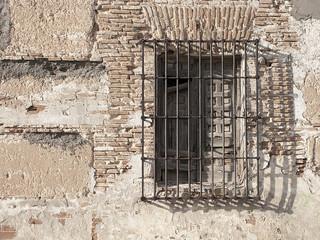 Rural window, spanish architecture, bricks wall and wooden detai