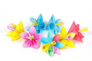 Seven colored paper flowers and flower with varicolored petals