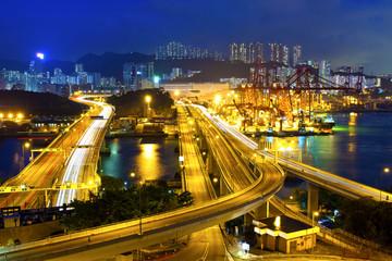 Cargo terminal traffic in city at night